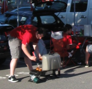 Albie at a tailgate using the old grill