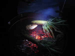 Corn and Chicken on the grill at night