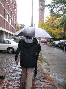 All of us under umbrellas and coats